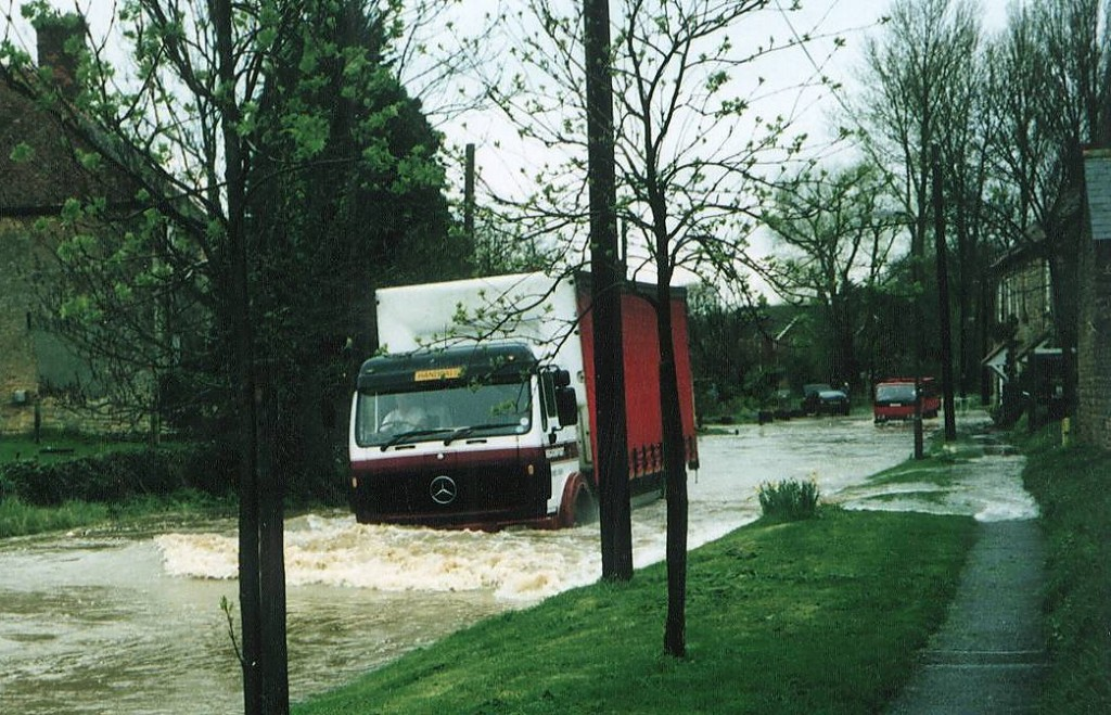 Lorry with bow wave charging past Causeway House.